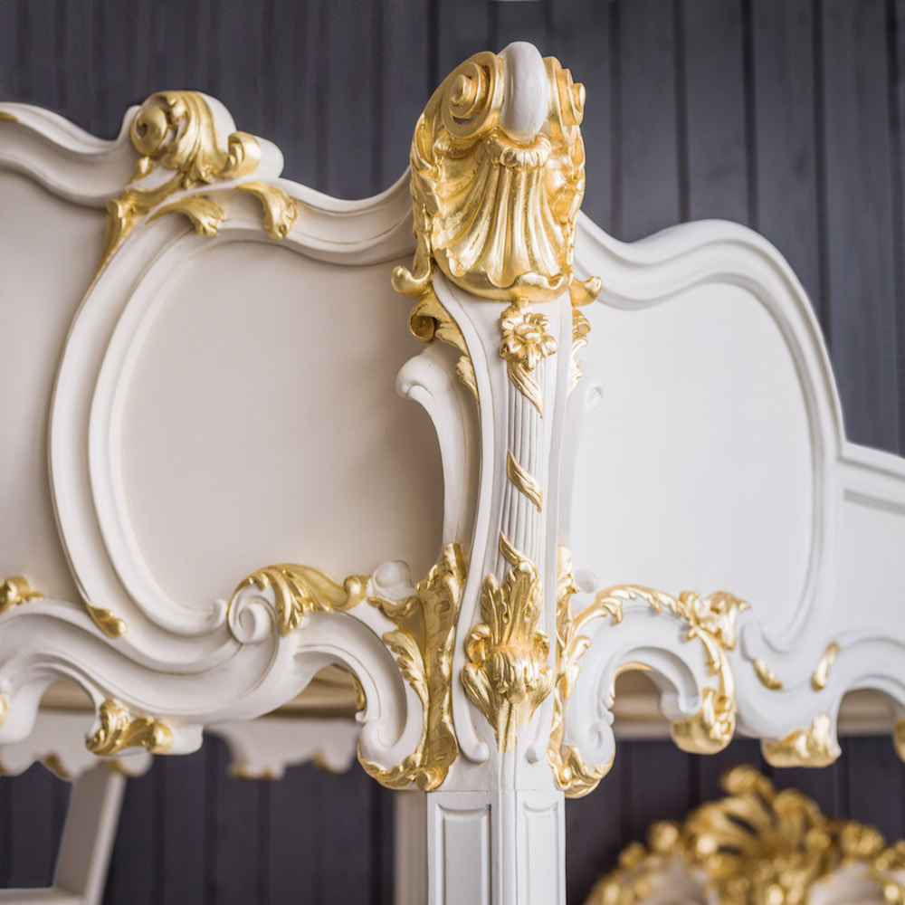 A close-up of the gold and cream double bunk bed