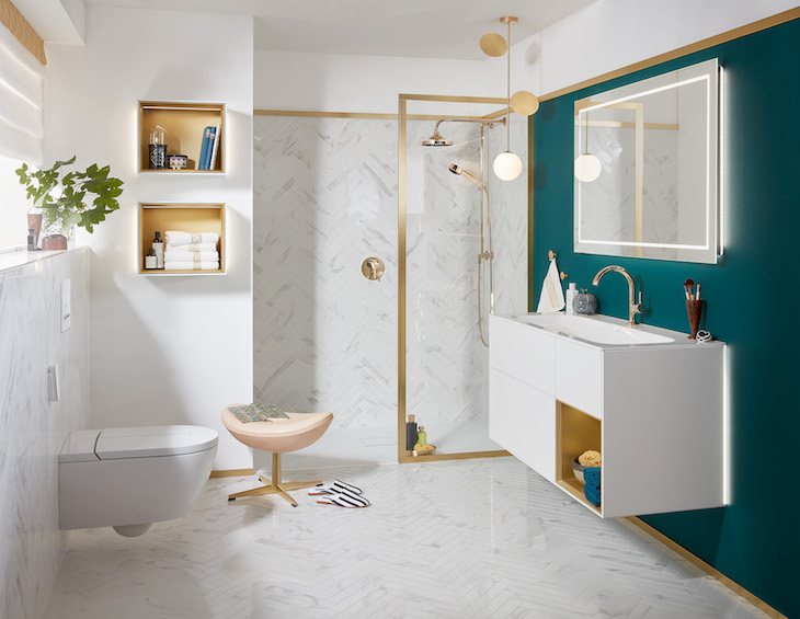 A modern bathroom with gold fittings and white and blue interior design scheme