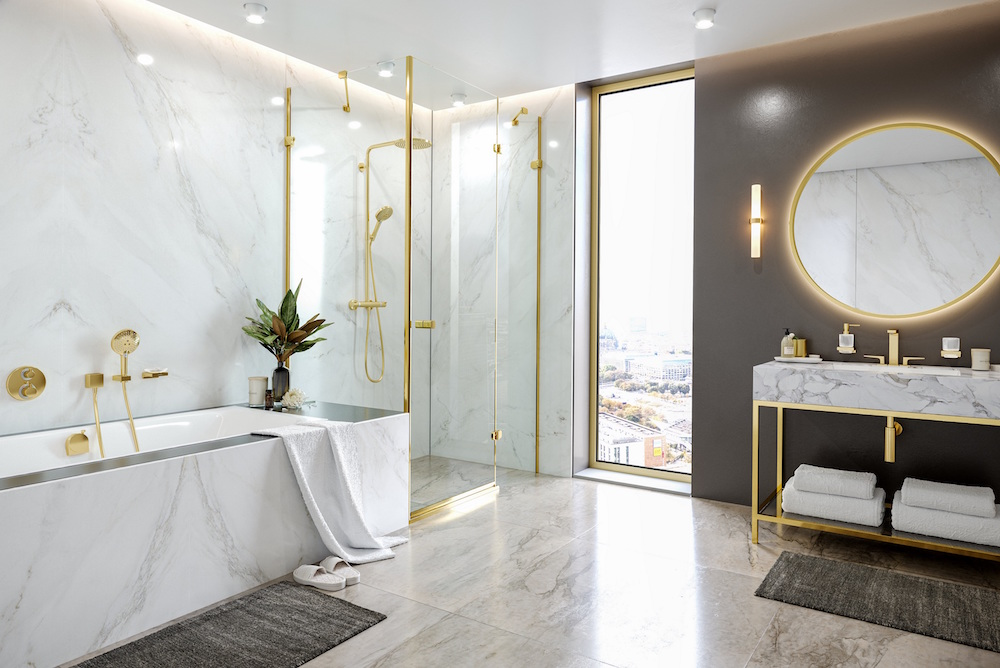 Image caption: hansgrohe polished gold optic shower and taps in the FinishPlus range. | Image credit: hansgrohe/UK Bathrooms