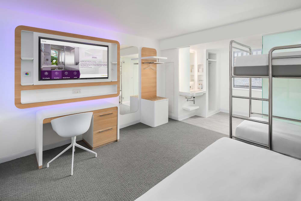 Modern, clean and slick guestroom inside YOTEL Edinburgh