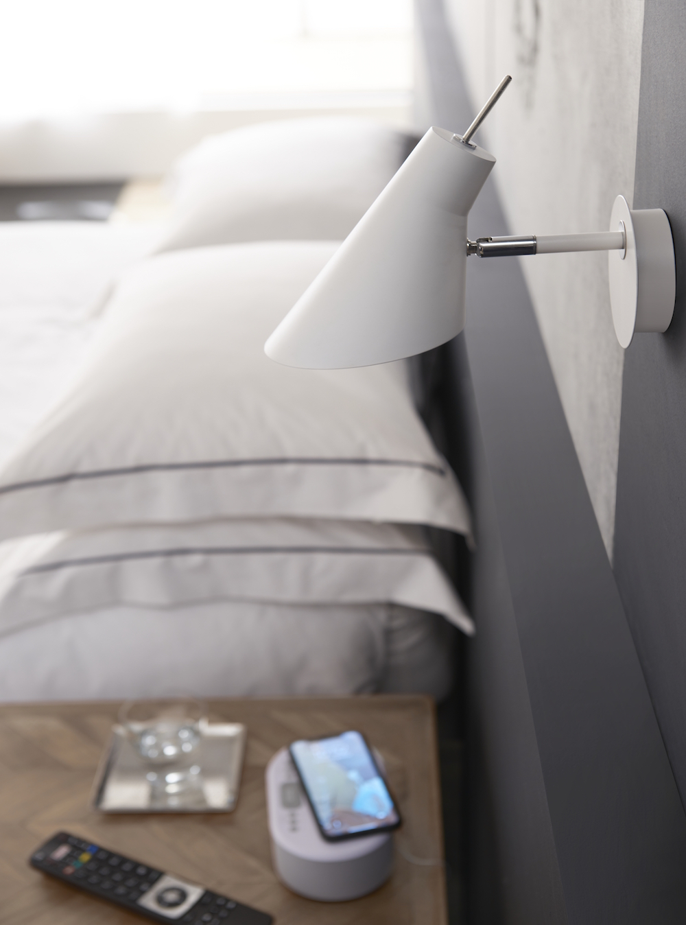 Image of phone at the side of the bed
