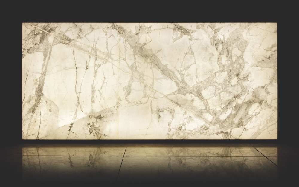 Image caption: When illuminated, Luce's special body gives a soft glow and really transforms the design from a plain tile to a soft natural marble, perfect for gently lighting up public spaces within the hotel after dark.