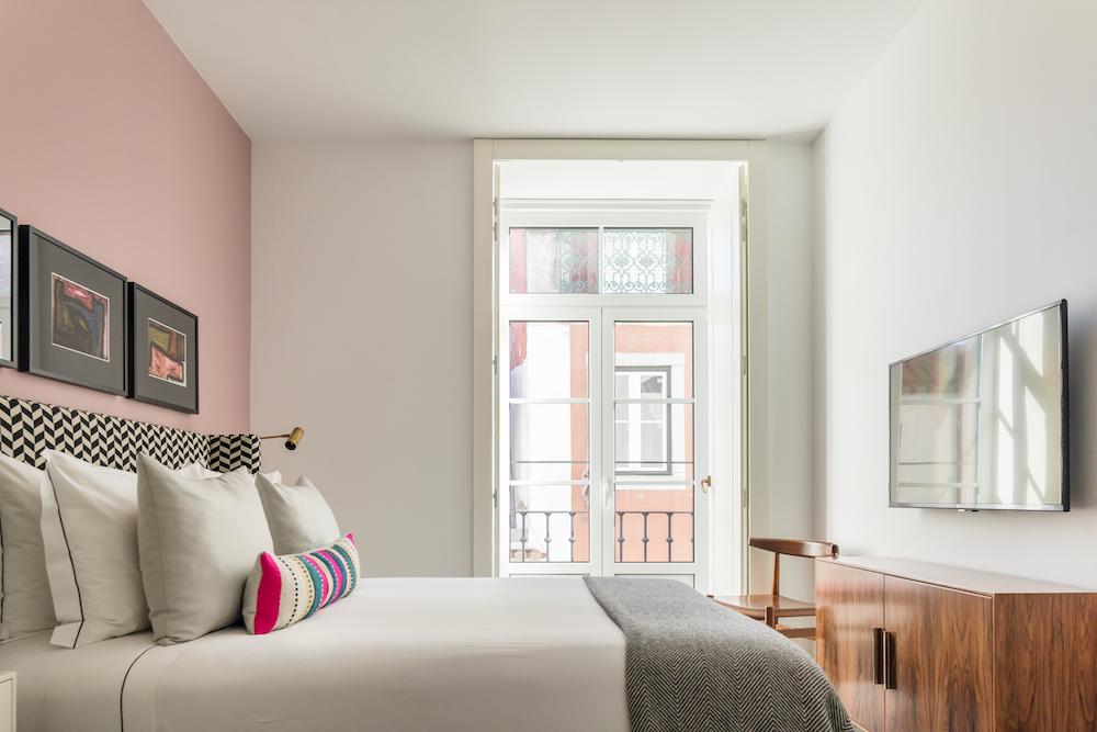 Pink guestroom inside Image credit: Luminares, Lisbon