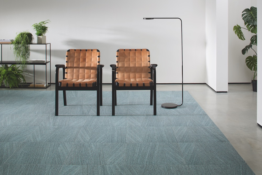 An empty room with carpet and industrial chairs
