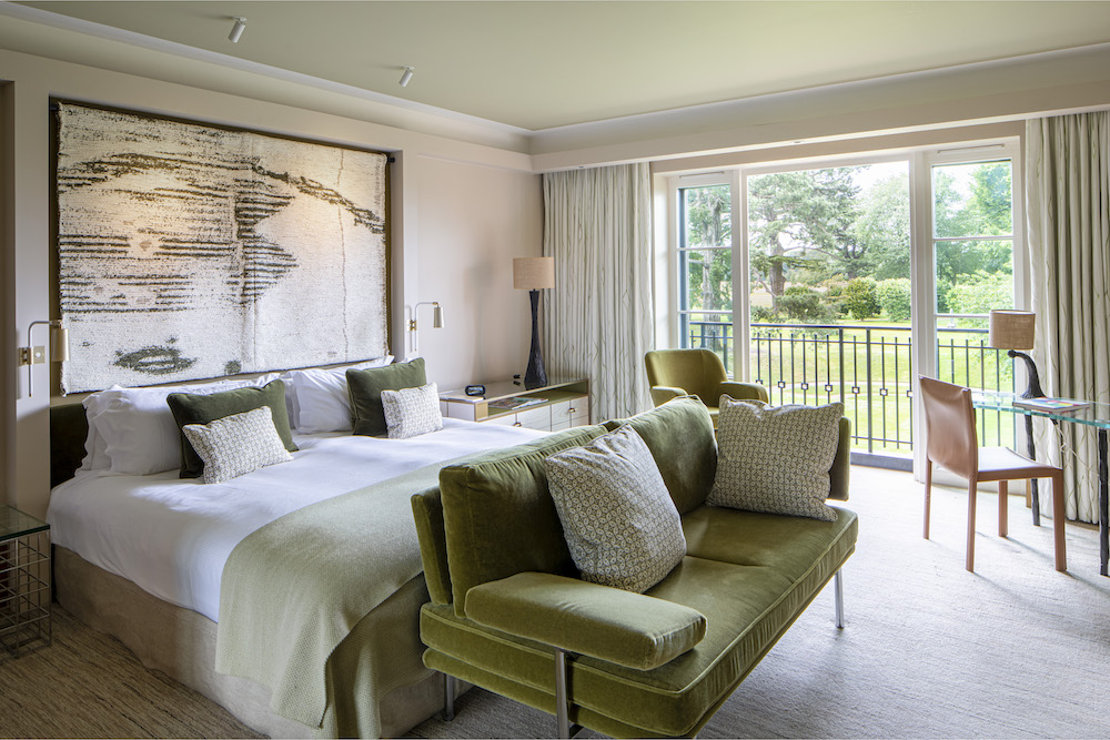 Image caption: Hulbert has employed a bright and airy scheme of neutral tones in tandem with seasonal green and rich sepia, inspired by the endless English countryside outdoors. | Image credit: The Grove, Hertfordshire