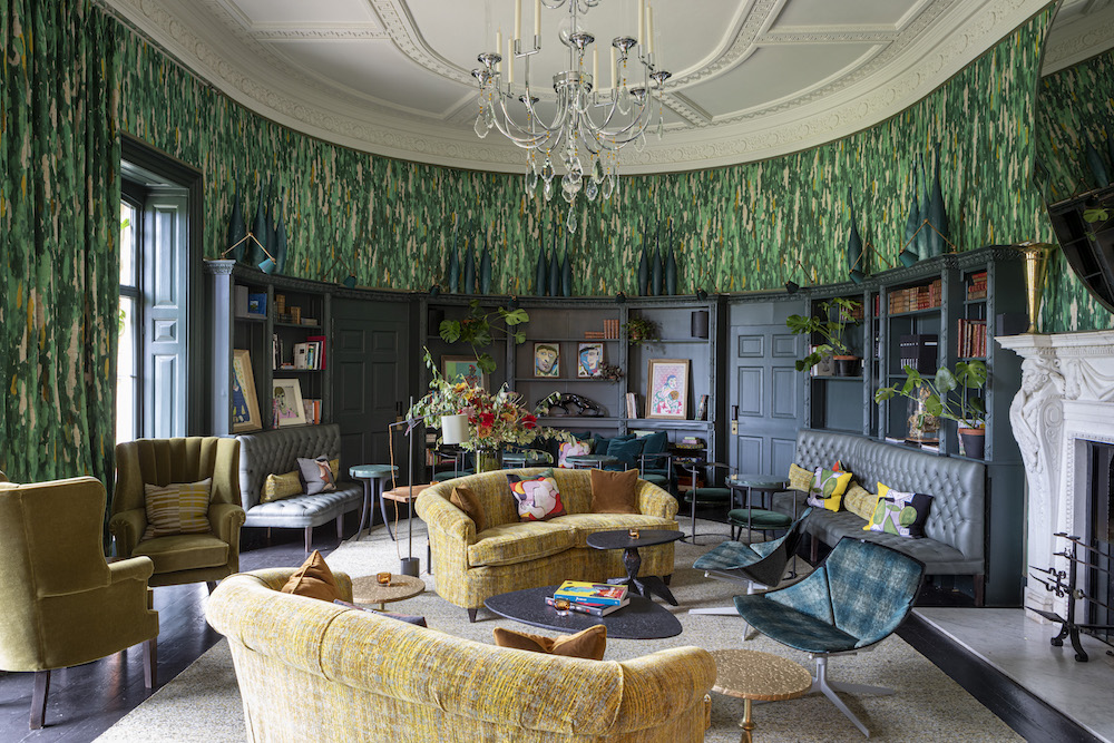 A loud lounge with biophilic walls