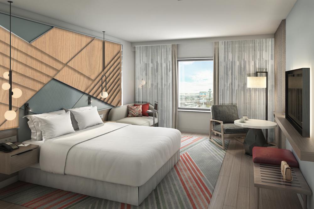Render of king bedroom inside Sheraton hotel