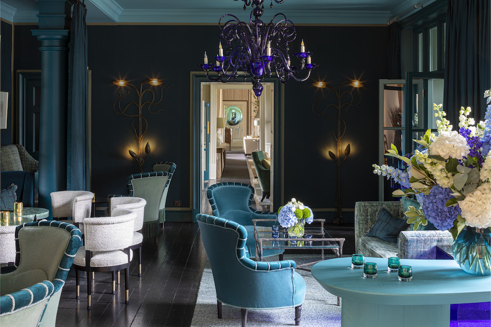 Image caption: The Blue Lounge is one of three lounges that have been recently redesigned. This area includes a striking Murano chandelier that demands attention when guests pass through this area of the hotel.   Image credit: The Grove Hotel, Hertfordshire