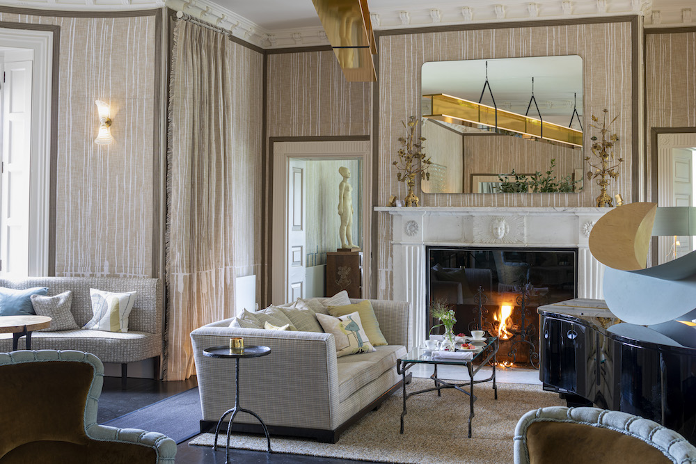 Image caption: In one of the lounges, the designer even commissioned a large gold beam to hang on the ceiling because, well, why not? | Image credit: The Grove Hotel, Hertfordshire