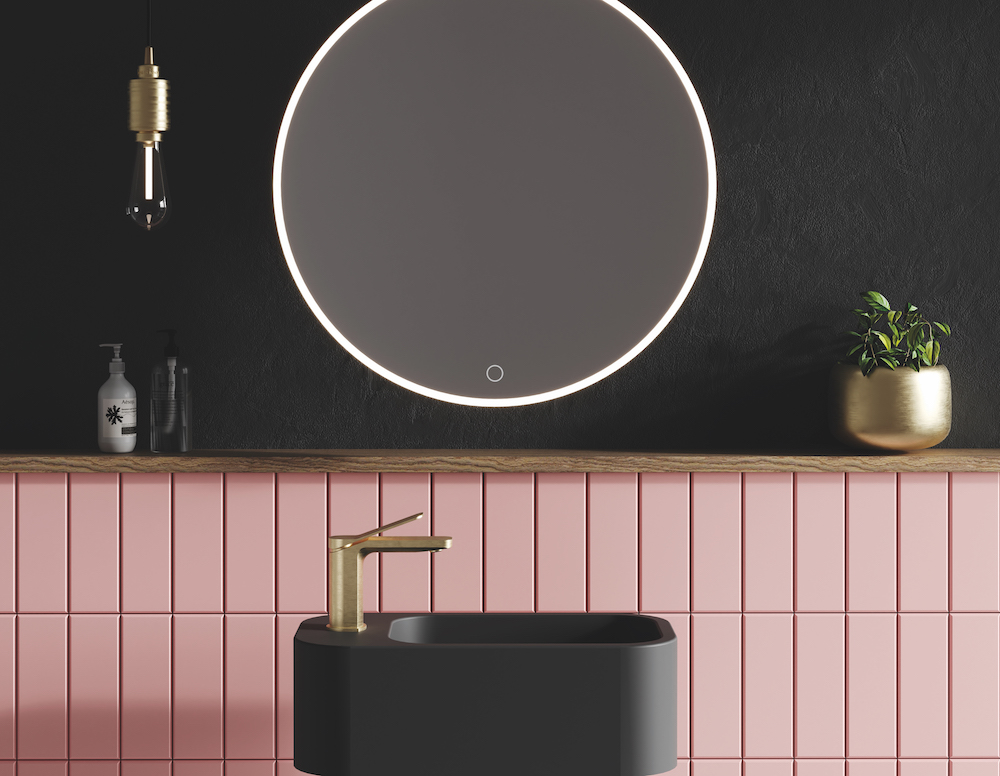 Black and pink bathroom with brassware