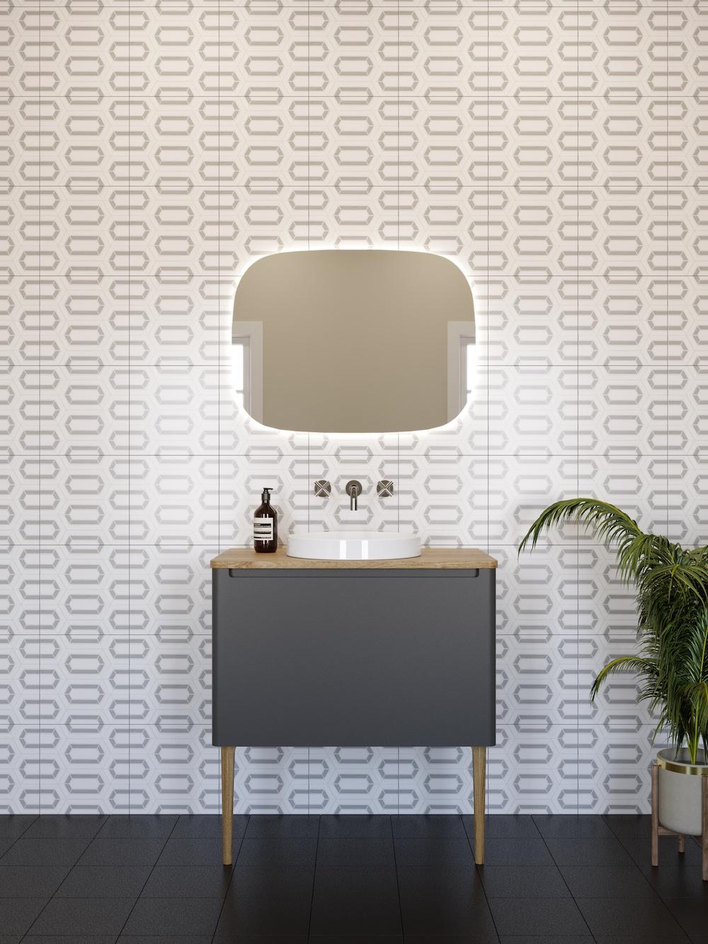 A black vanity sink in front of creative wallpaper