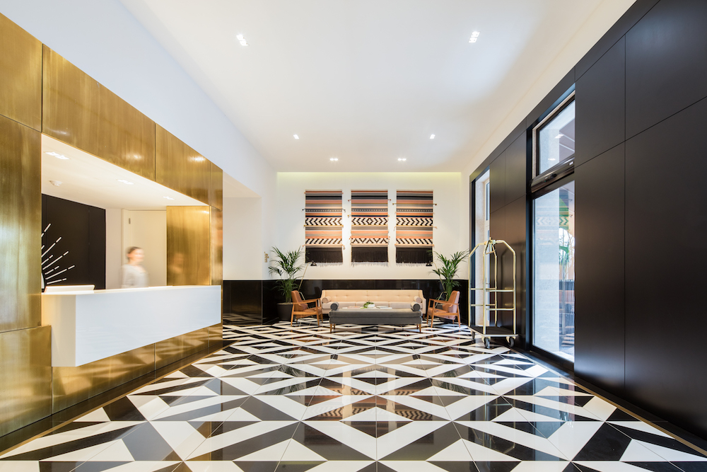 A gold and black and white open lobby in Lisbon
