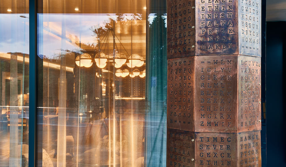 Image caption: The enigma column outside the hotel, in homage to Alan Turing, is the first indication that The Fellows House in Cambridge will shelter a deep design narrative. | Image credit: The Fellows House Cambridge