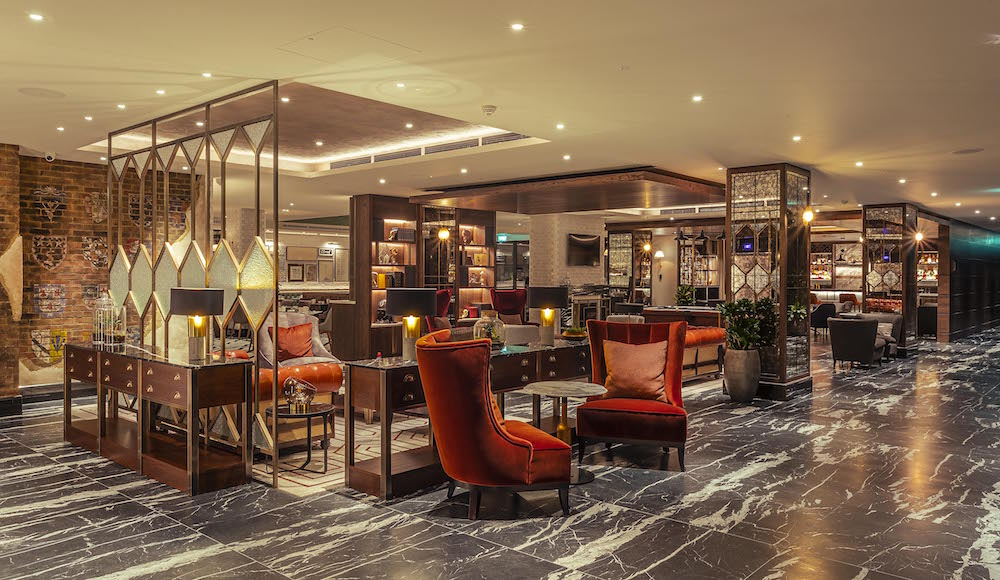 Image caption: The colour pallete of the lobby/lounge and The Folio Bar is dark and rich to reflect that of a private memebers' bar. | Image credit: The Fellows House Cambridge