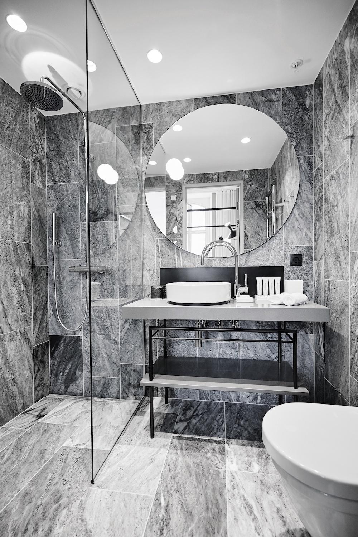 Grey, marble-like bathroom