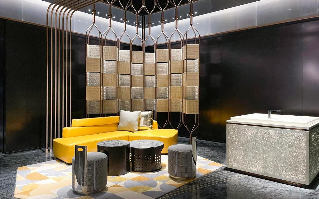 A yellow sofa in black room