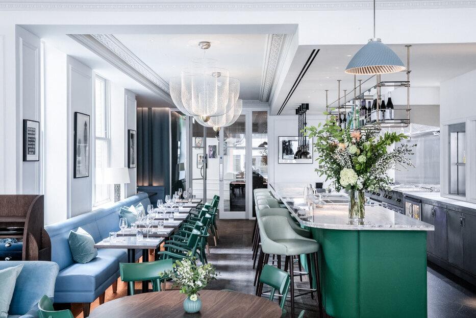 A modern, green and light bar and restaurant