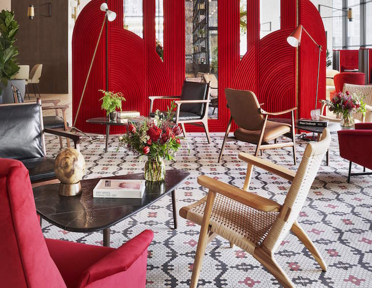 Red lobby inside the first Canopy by Hilton property in Spain
