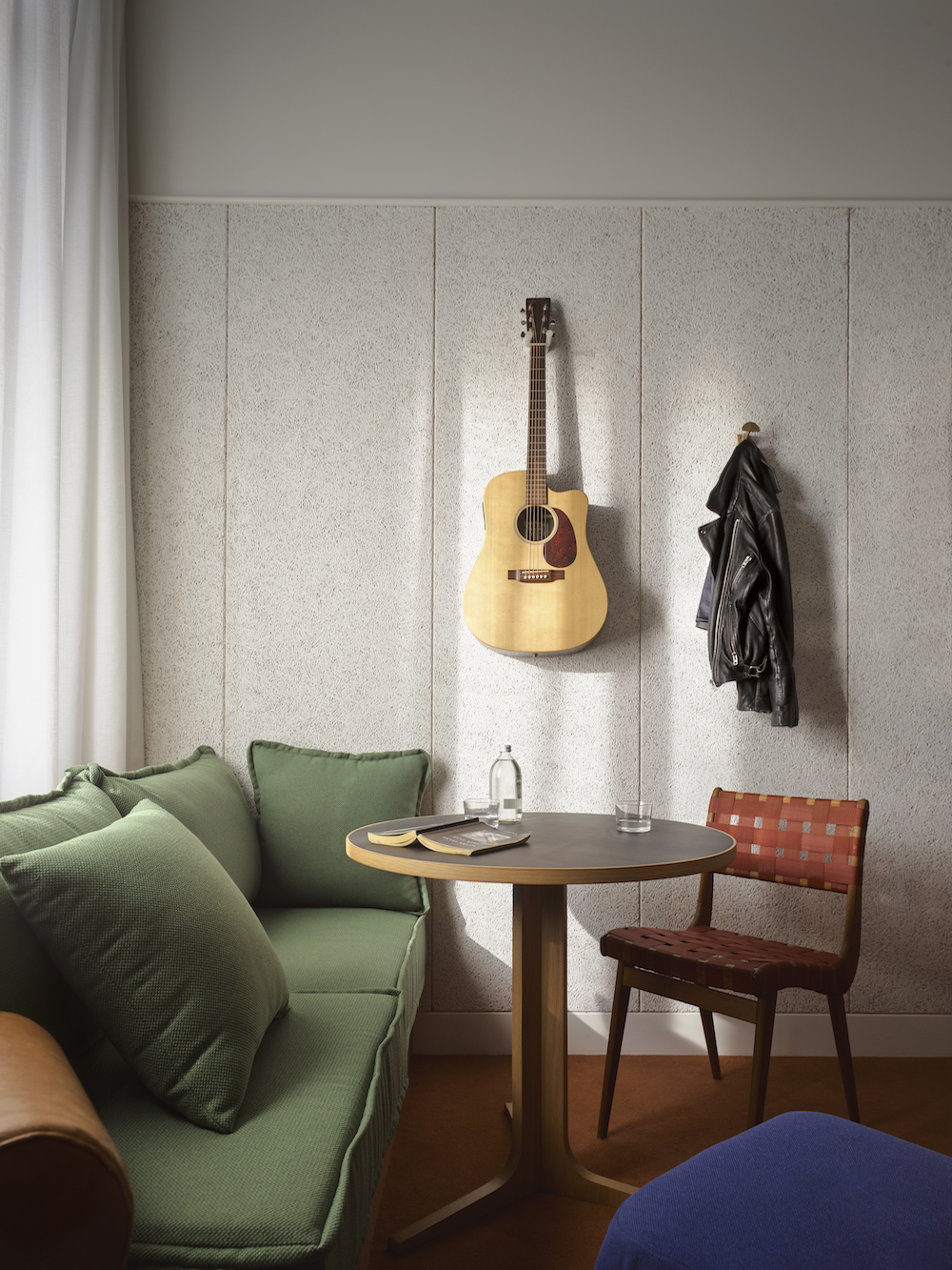 A guitar on the wall of a suite inside Ace Hotel Sydney