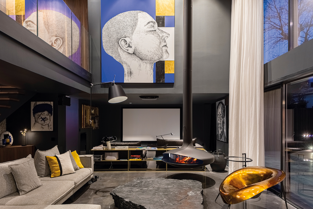 Hotel Designs | Modern lounge with black matt fireplace
