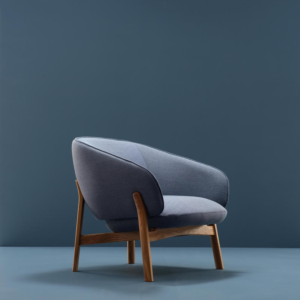 Blue armchair in a blue room