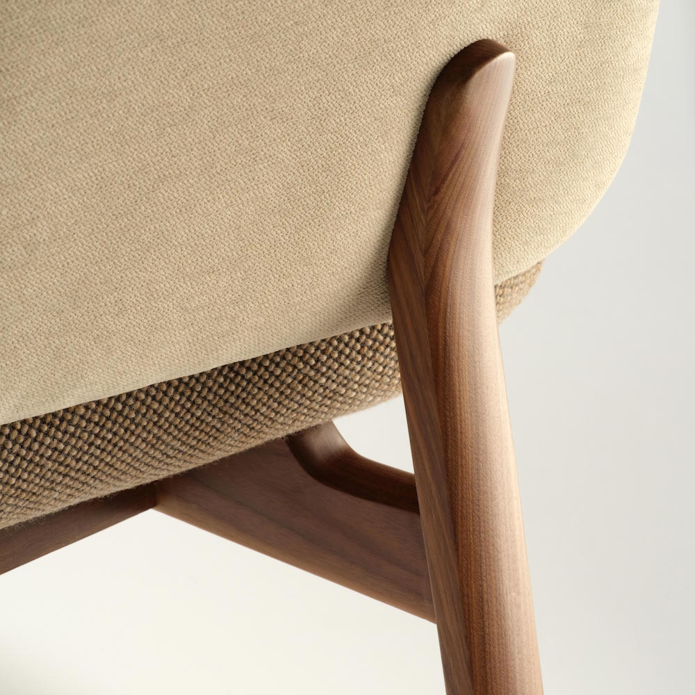 Close up of a beige armchair