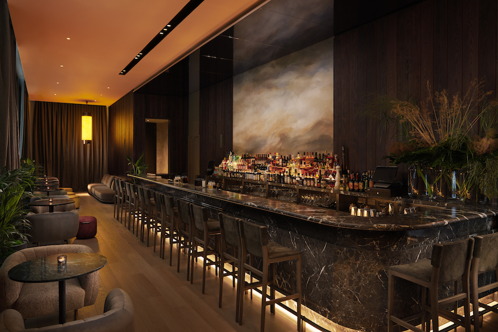 A dark and atmospheric bar inside Pan Pacific London