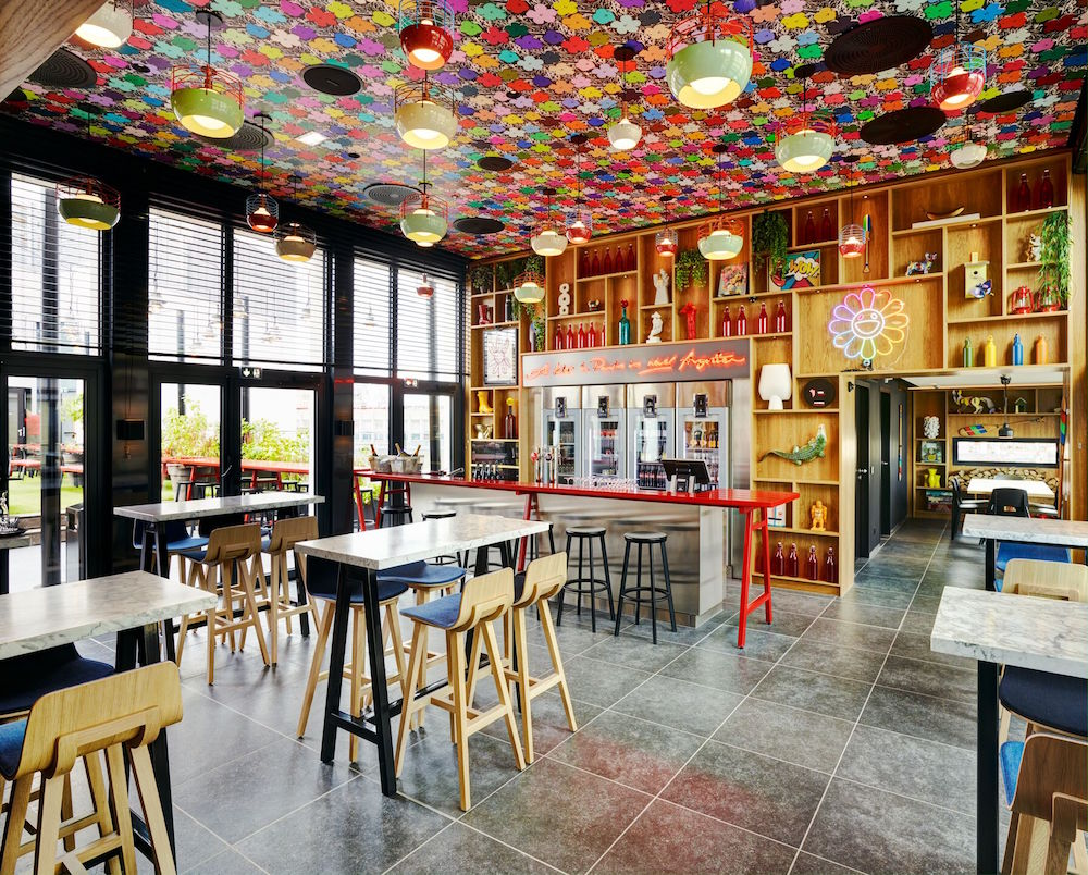 a colourful ceiling in public areas in citizenM
