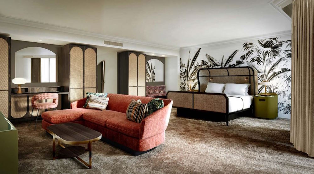 Hotel designs | A large suite with rattan bed and plush furniture