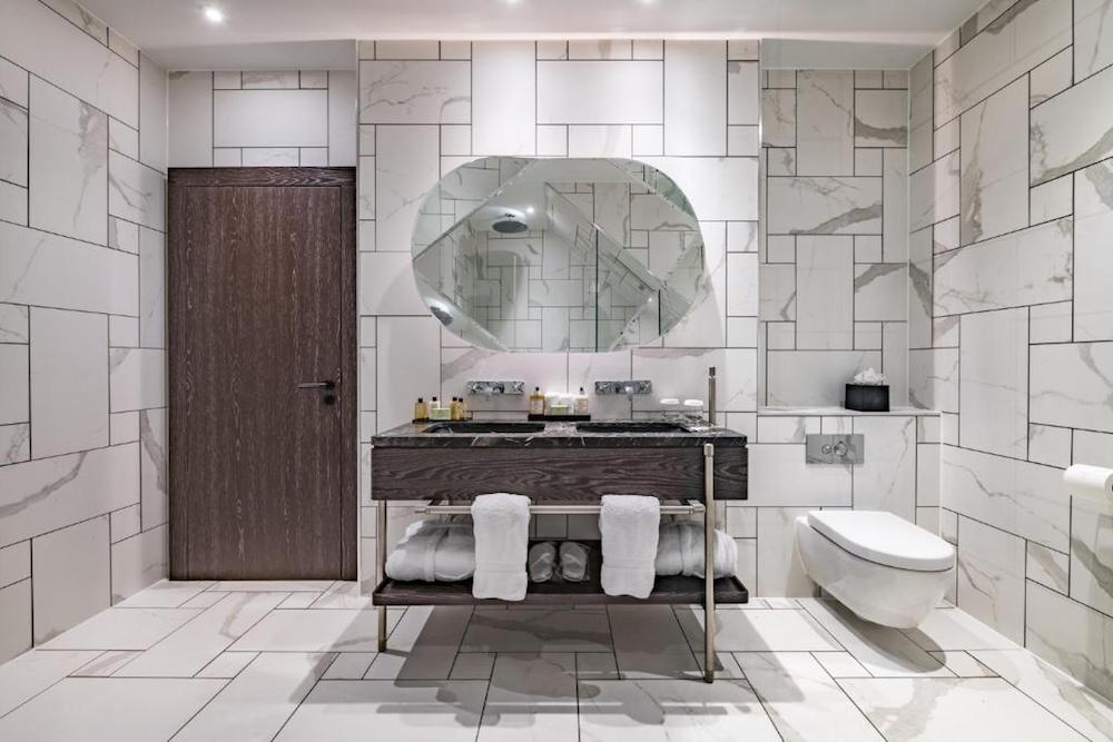 Image caption: The bathrooms inside Stock Exchange Hotel in Manchester, designed by Space Invader (specified by Utopia Projects). | Image credit: Stock Exchange Hotel