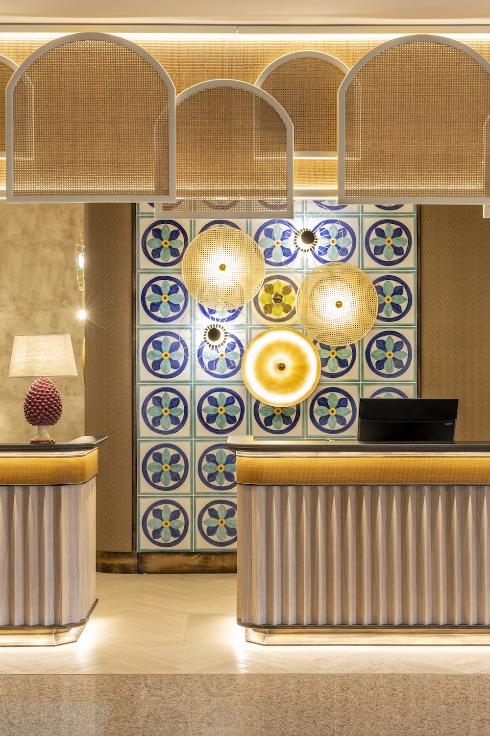 Crafted lobby check-in area inside a luxury hotel in Italy