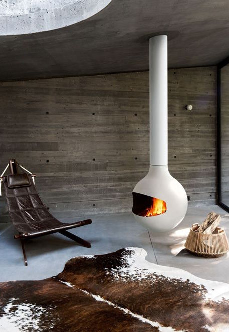 A white fireplace in cosy living space