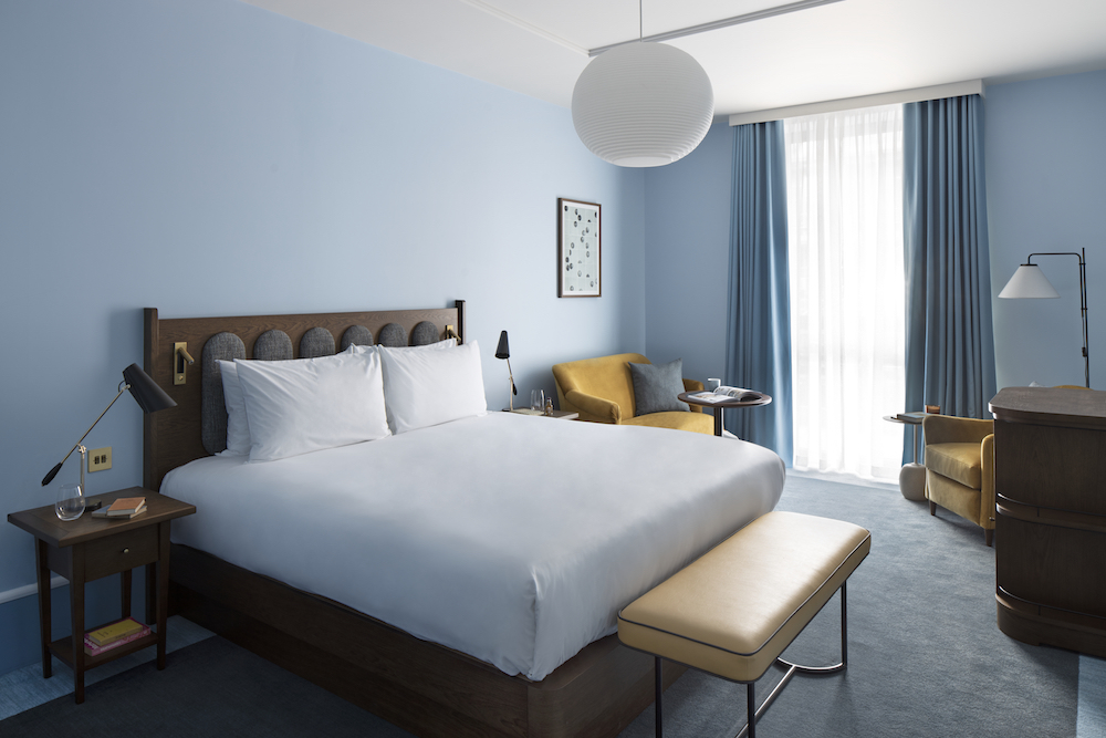 A blue large bedroom inside the Hyatt Centric hotel in Cambridge