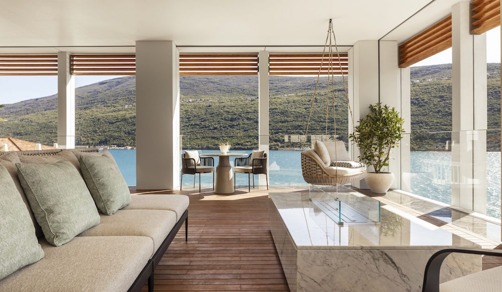A luxury suite with balcony that overlooks sea