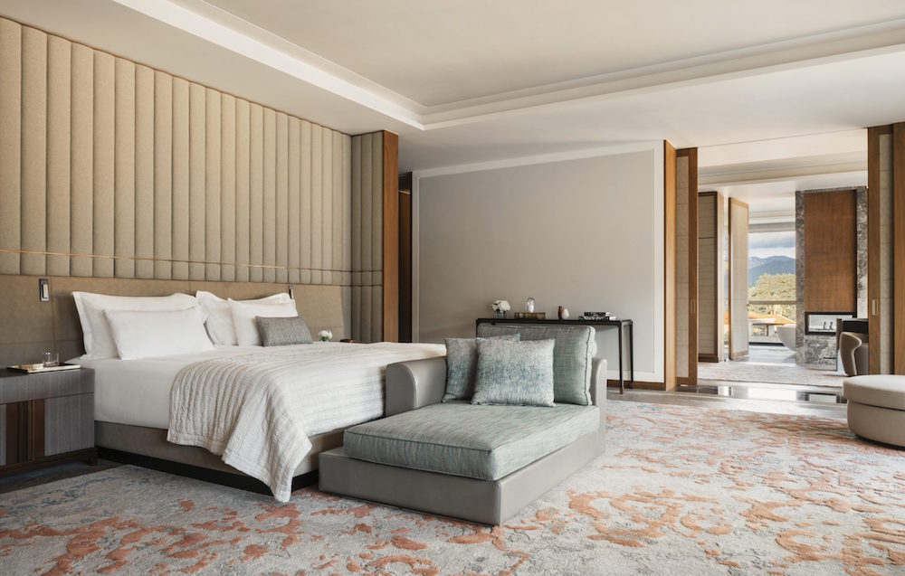 A large cream headboard in large and luxurious bedroom