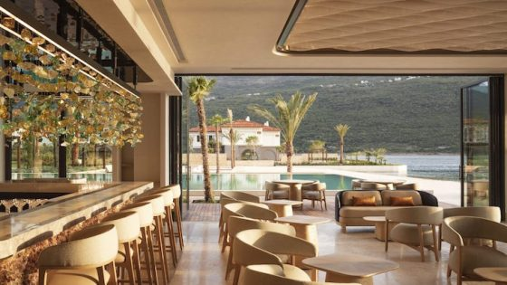 An airy dining area inside One&Only Portonovi overlooking pool and sea