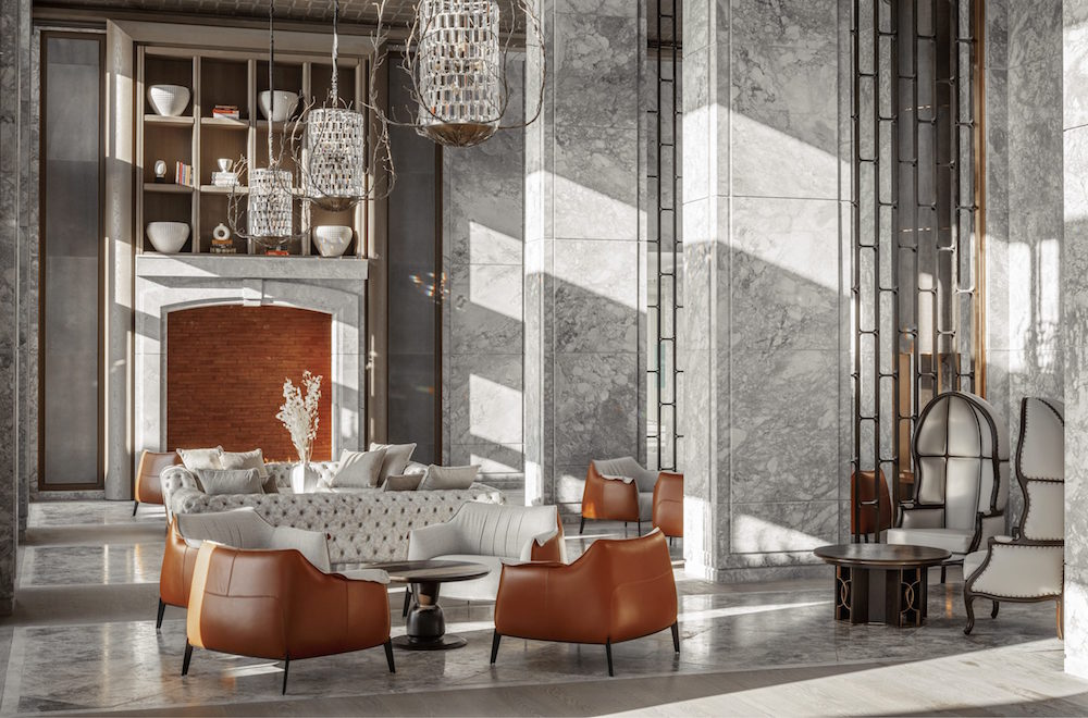 A high-ceilinged marble lobby with leather furniture