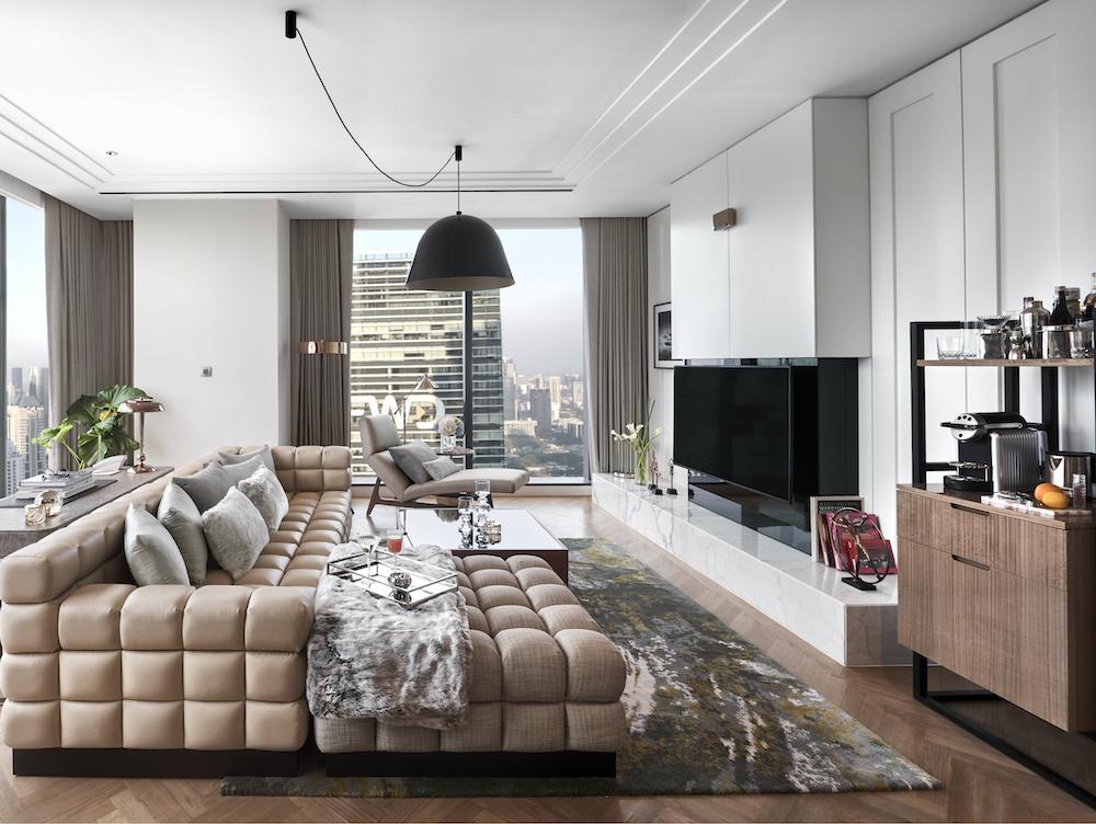 An expansive lounge inside suites in Langham, Jakarta